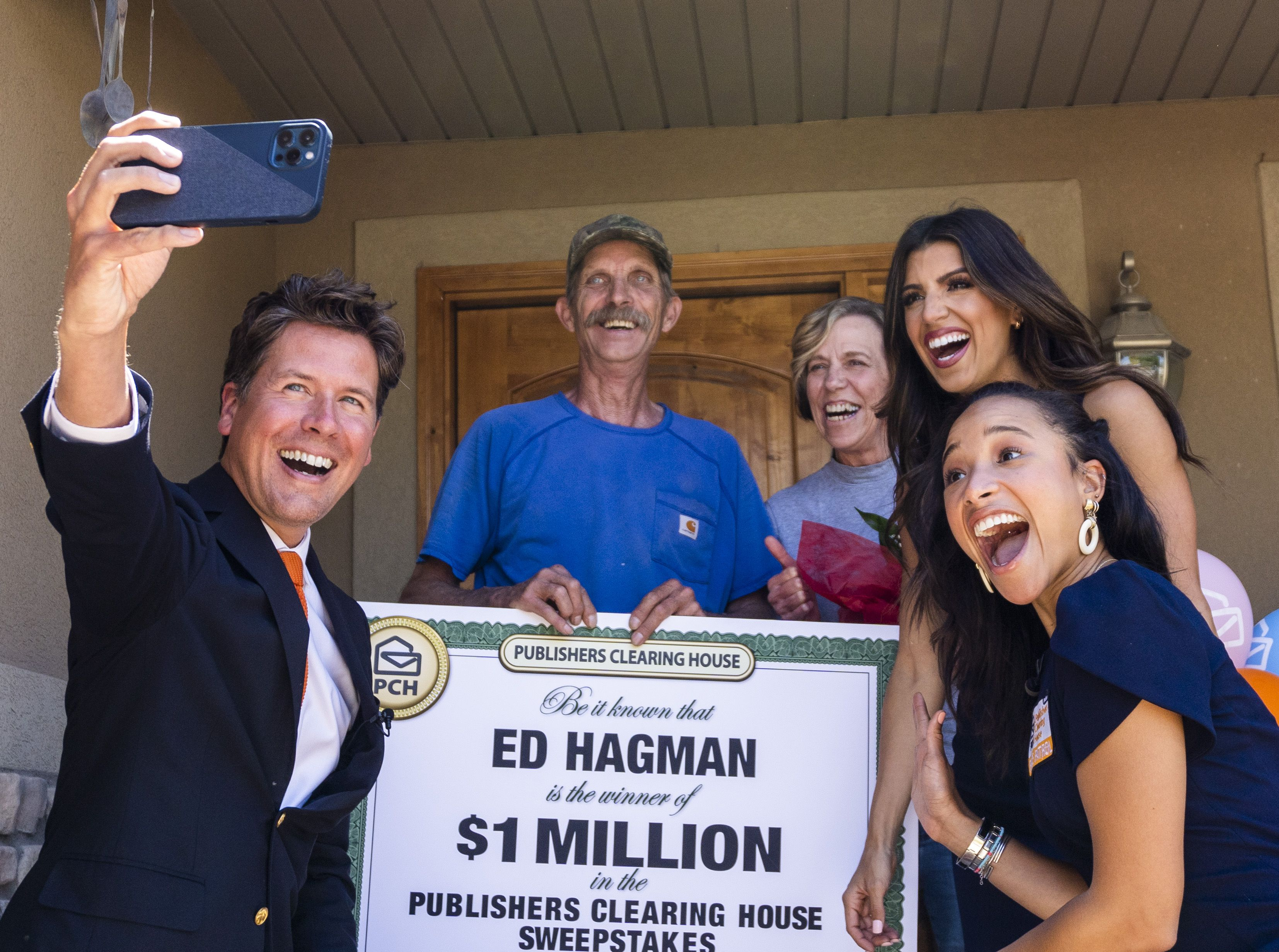 (Rick Egan | The Salt Lake Tribune) Members of the Prize Patrol from Publishers Clearing House, from left,  Howie Guja, Danielle Lam and Bianca Quinnonez, take a selfie with Ed and Denise Hagman, after delivering the news that the Hagman's won $1,000,000, at their home in Herriman, on Friday, May 28th