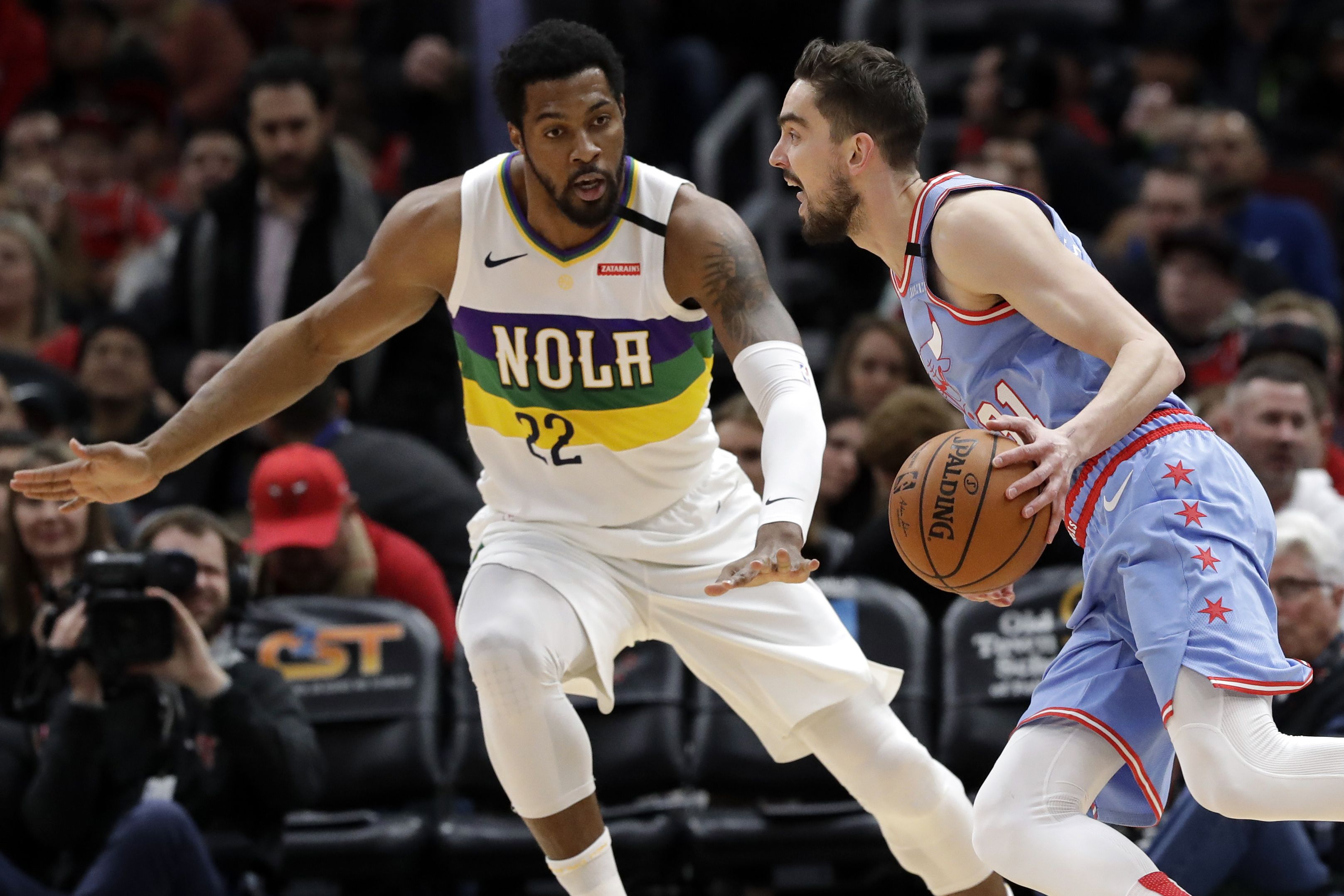 Chicago Bulls guard Tomas Satoransky, right, drives against New Orleans Pelicans center Derrick Favors during the first half of an NBA basketball game in Chicago, Thursday, Feb. 6, 2020. (AP Photo/Nam Y. Huh)