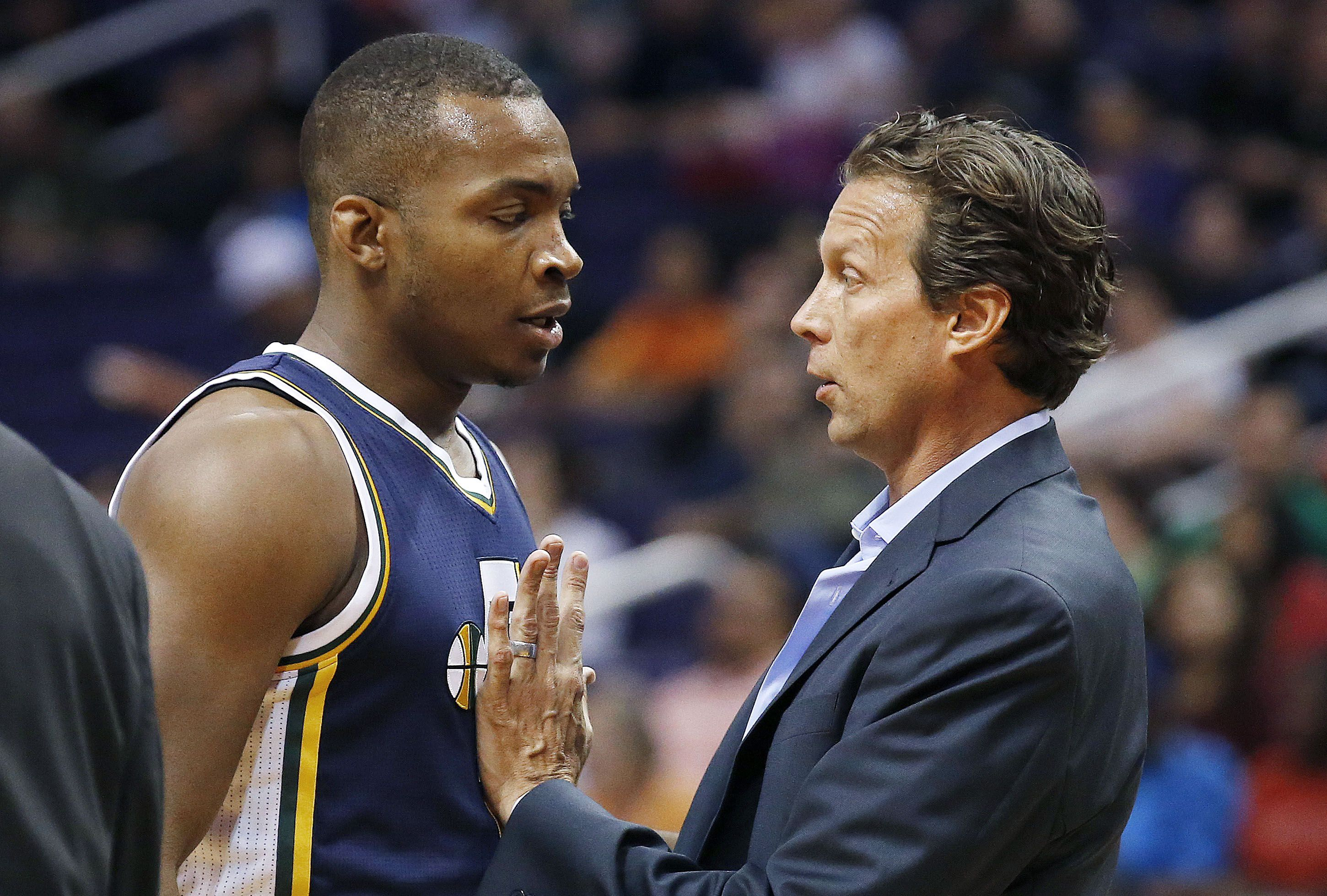 Utah Jazz head coach Quin Snyder, right, talks with Elijah Millsap during the first half of an NBA preseason basketball game against the Phoenix Suns, Friday, Oct. 9, 2015, in Phoenix. (AP Photo/Ross D. Franklin)