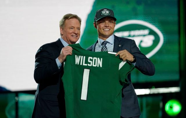 (Steve Luciano   AP) BYU quarterback Zach Wilson, right, poses for a photo with NFL Commissioner Roger Goodell after being drafted by the New York Jets in the first round of the NFL football draft, Thursday, April 29, 2021, in Cleveland.