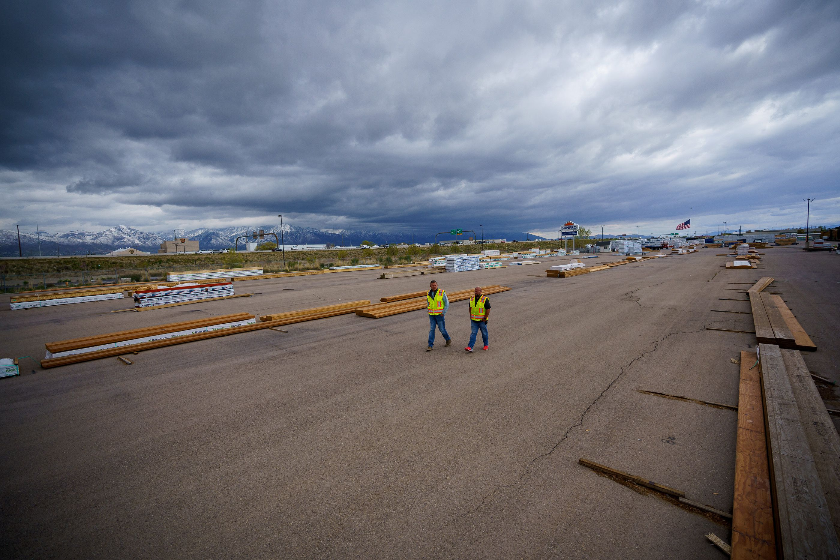 (Trent Nelson     The Salt Lake Tribune) Jason Butterfield and Jason Barnett walk through the sparse yard a Sunpro in Salt Lake City on Tuesday, April 27, 2021. A national shortage of lumber is stalling and driving up costs on big construction projects and small home improvements alike in Utah.