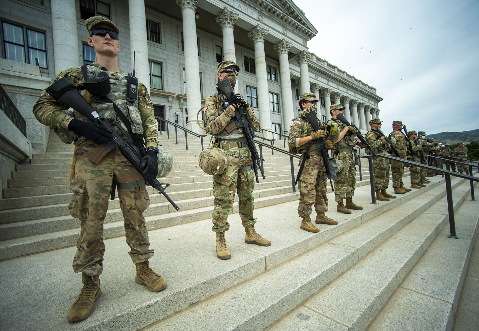 (Rick Egan  |  The Salt Lake Tribune) Members of the National Guard stand on the steps of the Capitol, along way back from the hundreds of protesters across the street from the Capitol, during a George Floyd, demonstration in Salt Lake City on Thursday, June 4, 2020.