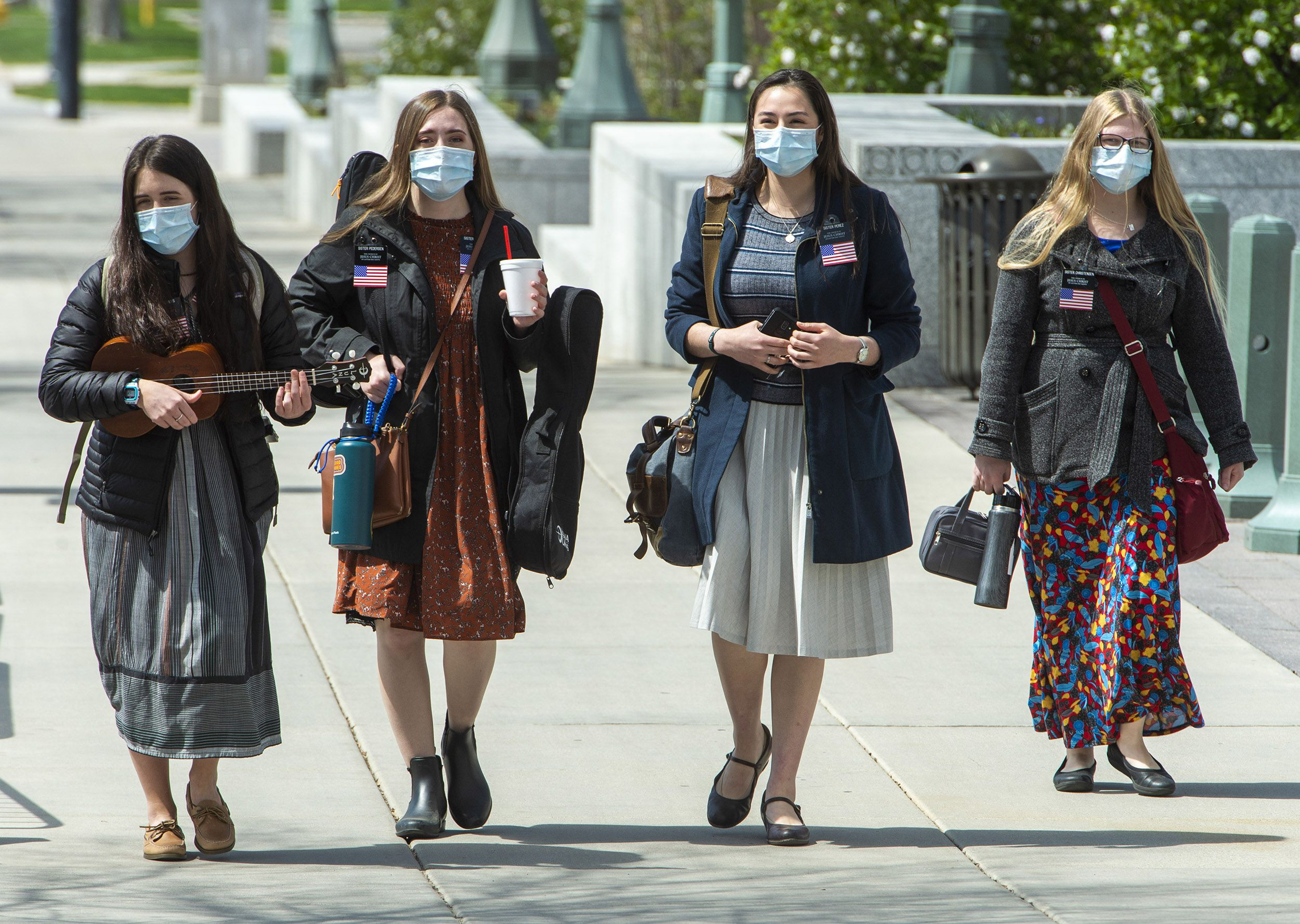 (Rick Egan  | Salt Lake Tribune file photo)  Latter-day Saint missionaries wear masks in April 2020 in downtown Salt Lake City. The church is encouraging but not requiring its missionaries in Utah to be vaccinated against COVID-19.