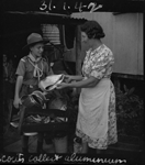 Giving alumiunium to scout, 1942