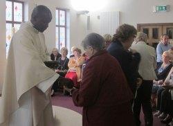 Fr-Ignatius-distributes-Com
