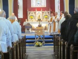 Fr Tom rests before the Altar