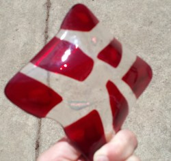 Back of Clear, Red, and Yellow Glass Dish