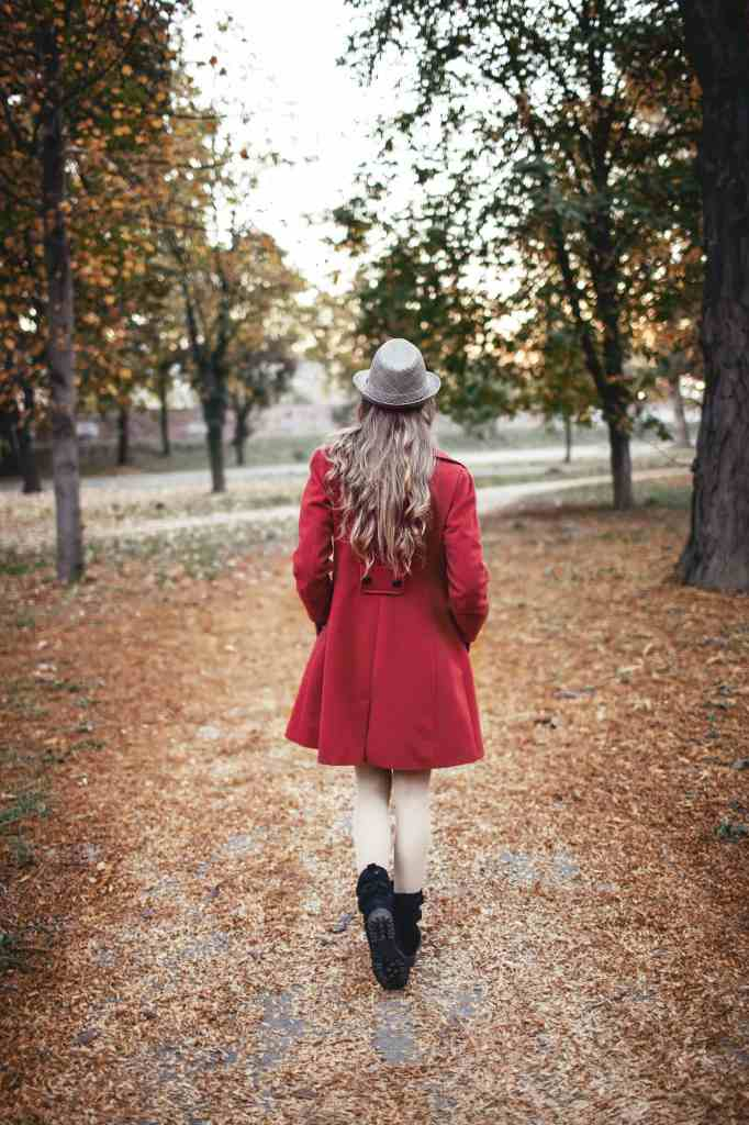 Woman walking in the park, photo in vintage style