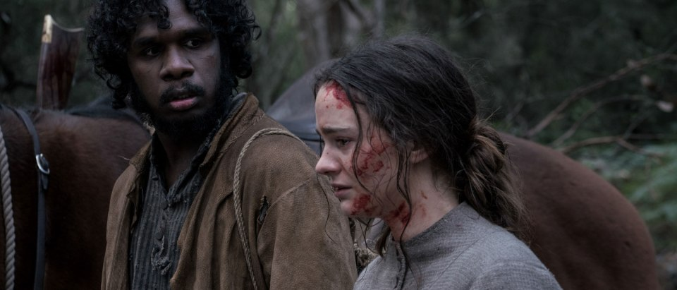 Baykali Ganambarr as Billy and Aisling Franciosi as Clare in The Nightingale (Credit: IFC Films)
