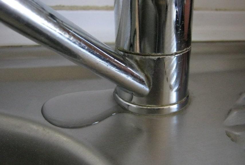 kitchen sink faucet leaking at base