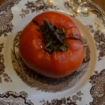 An Ichi Ki Kei Jiro Asian persimmon, grown in my yard, on a plate.