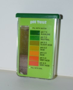 Soil sample in pH test kit with water and indicator powder, to read the soil pH.