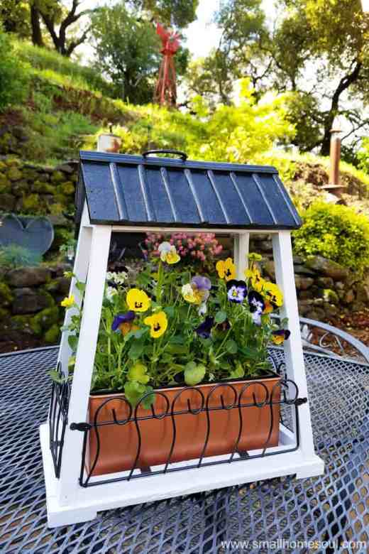 Put the hanging flower pot in a sunny spot in your yard for pretty flowers.
