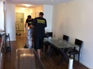 2 men moving a dresser, downtown condo