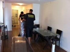 2 men moving a dresser, downtown condo