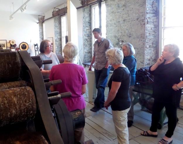 Lizz recounts the conservation history of a carding machine at the inaugural workhop at the  Mississippi Valley Textile Museum, Almonte, ON, May 2015.