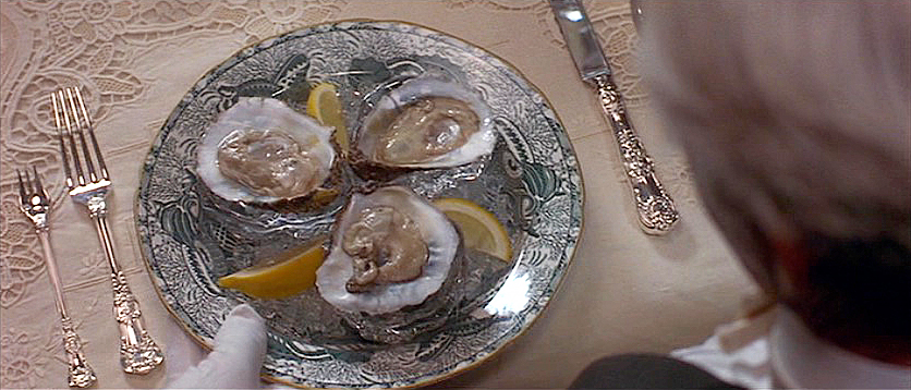(above) Oysters on ice is the first course. There should be three forks in this scene. You'll notice why if you study the still following the next one.