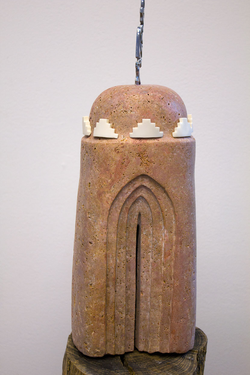 (above) '1971,' 2010, persian marble, bone, car emblem, 21.5 x 6.5 x 5 inches