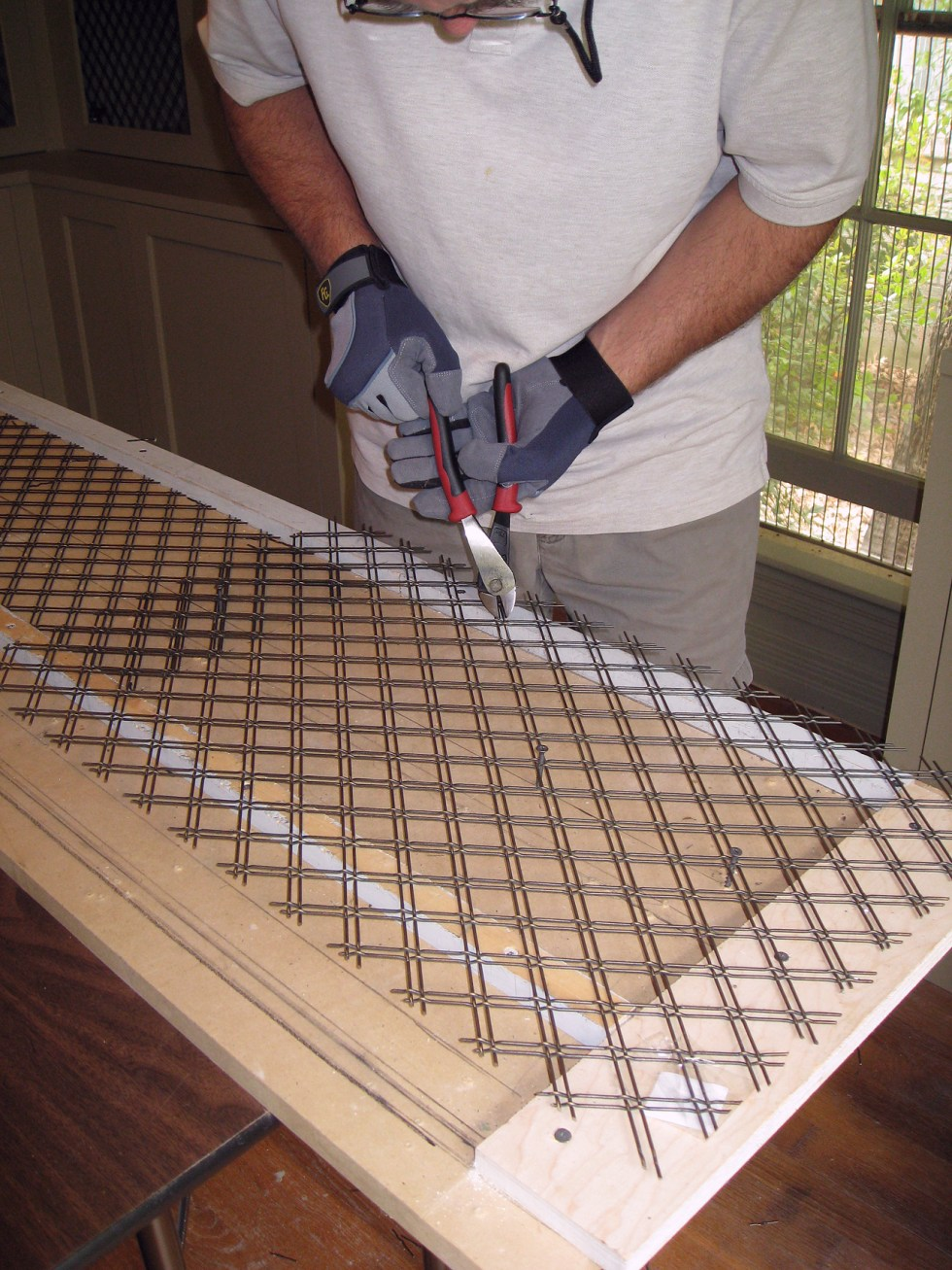 (above) Bert, my general contractor, is cutting the wire to size using an adjustable template.
