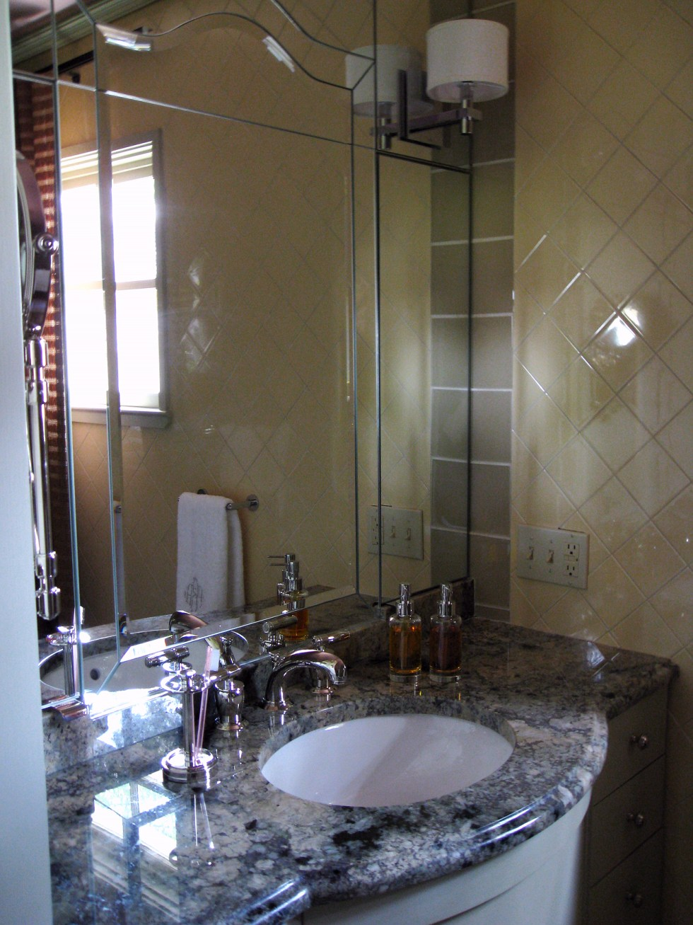 (above) The outcome of all Frances Elkins' influences, resulted in this recessed mirrored niche, combining a shaped vanity with a simplified Queen Anne-style mirror. On either side of the arch portion of the mirror are two panels that open to reveal medicine cabinets. Even though this space is not nearly as sumptuous as in Frances Elkins' designs, my vanity space is very precious to me, and I feel very lucky to have it.