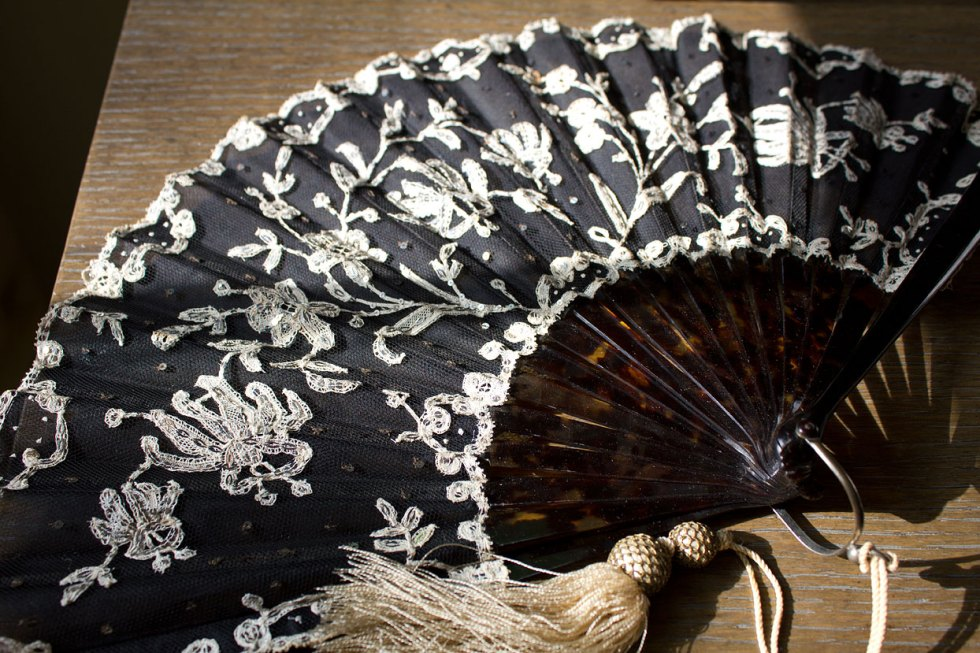 (above) Art Nouveau (circa 1880-1890) opera fan with black tulle fine net leaf and applied lace embellished with silver sequins and spangles. The sticks are undetermined natural or faux marbled shell.