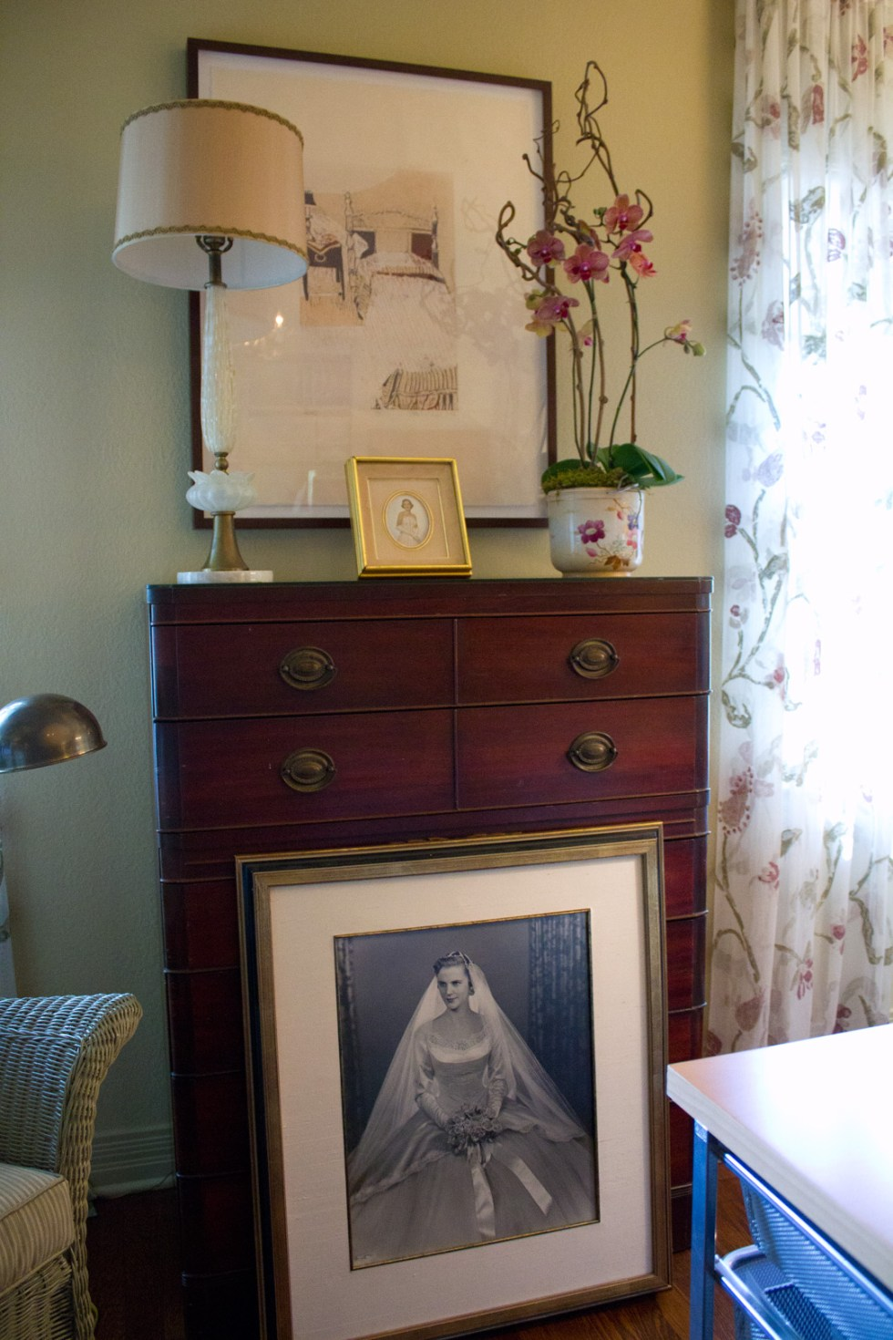 (above) Here's detail view of an old family bureau with my mother's wedding photo propped up in front. Hung above this old piece of brown furniture is a reductive woodcut I did about twenty years ago.