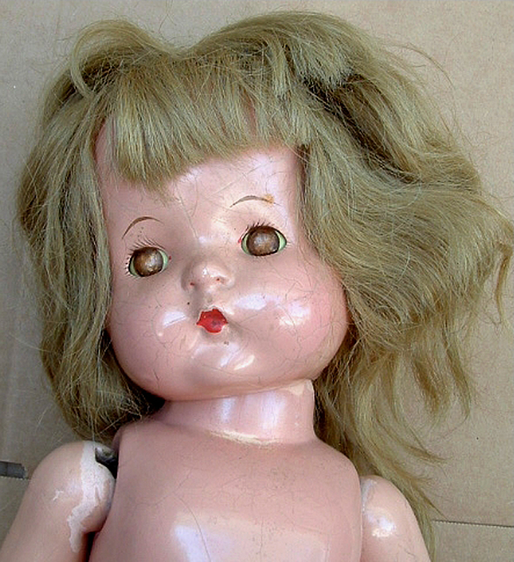 This is one doll from my collection of Patsy Ann dolls that I now keep locked up in the attic. Most of the nice looking ones were used in a promotional campaign back in 2001, but I never had the courage to use this particular one until now.