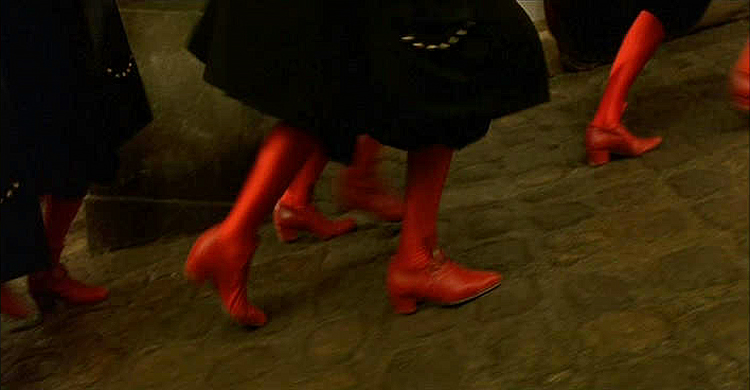 (above) The Prince of Condé's staff uniform pairs somber black with red silk stockings and red leather shoes.