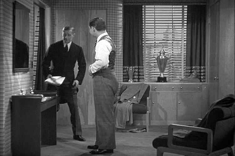 ((above) If a gentleman doesn't happen to have a flatscreen television in his personal dressing area, the butler can deliver a freshly ironed-dead-tree version of the daily news.