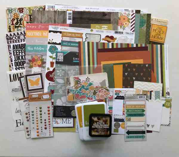 Scrapbooking supplies, cardstock, patterned paper, stickers, die-cuts, Ink pads, stencil to make a kit.