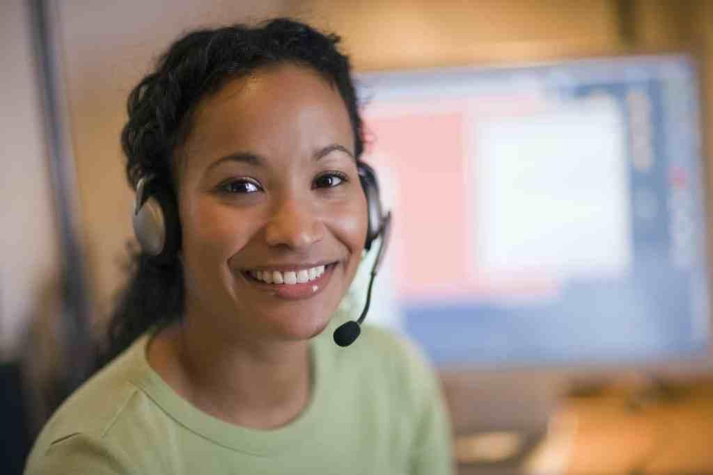 A woman wears a headset