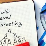 A notebook says multi level marketing.