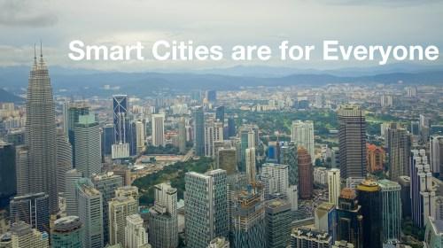 "Beautiful view of Kuala Lumpur from Menara Kuala Lumpur Tower - TEXT OVERLAY: ""SMART CITIES ARE FOR EVERYONE"""