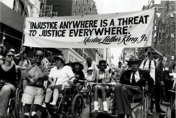 Activisits including Judith Heumann march to encourage the passing of the Americans with Disabilities Act Photo Tom Olin)