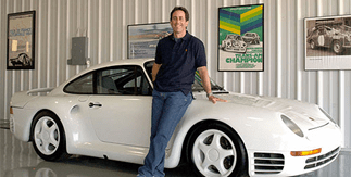 Jerry Seinfeld  standing with his Porsche 959