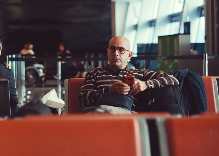 man on phone at airport.