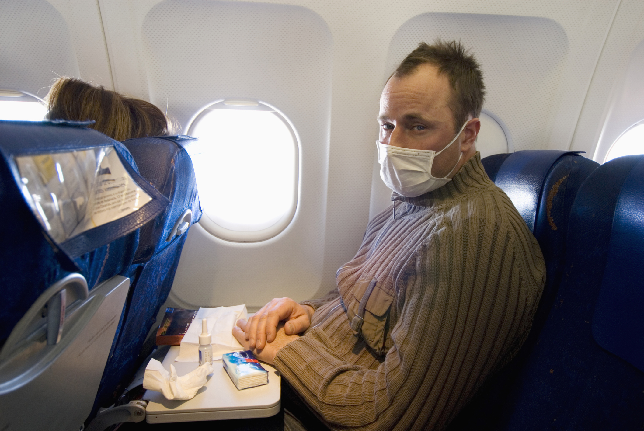 What to Do When Seated Next to a Sick Person on a Plane