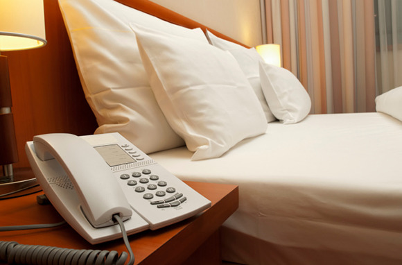 Confirm Visitors with the Hotel Desk