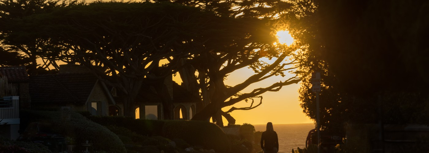 Woman walking at sunset in Carmel-by-the-Sea