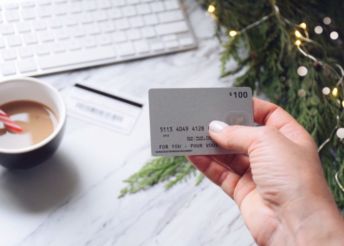 holiday-shopping-woman-s-hand-holding-a-credit-card-to-shop-online