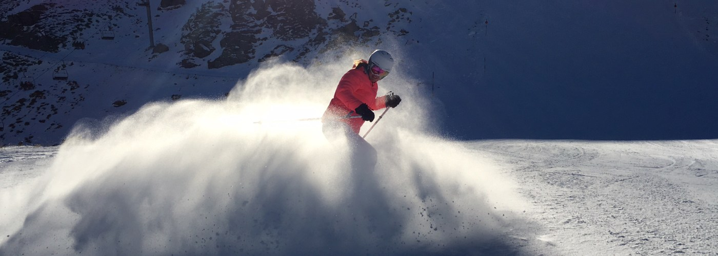 skier creating snow cloud