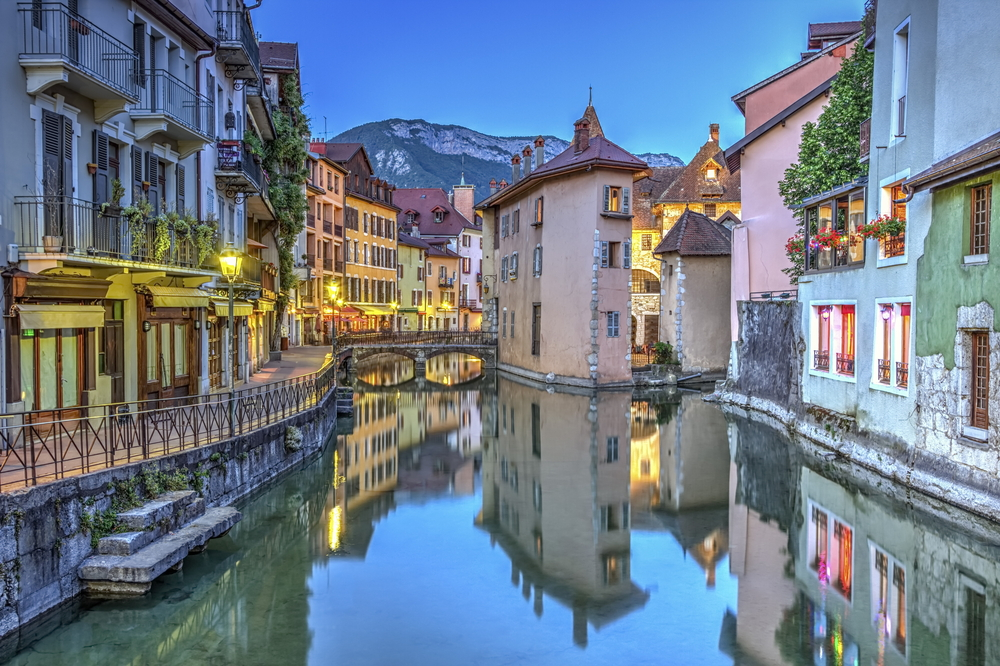 canals winding through buildings in european village.