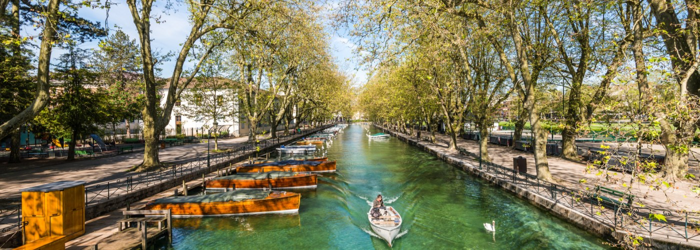 woman paddling boat on canal in france.