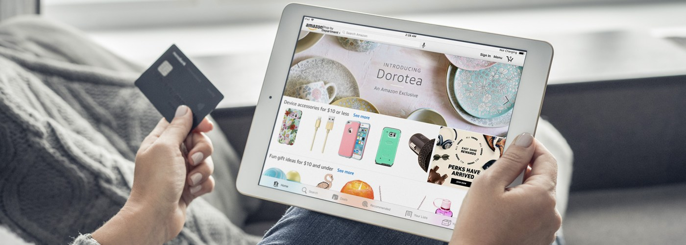 Woman using Amazon app on a brand new Apple iPad Pro Silver for online shopping