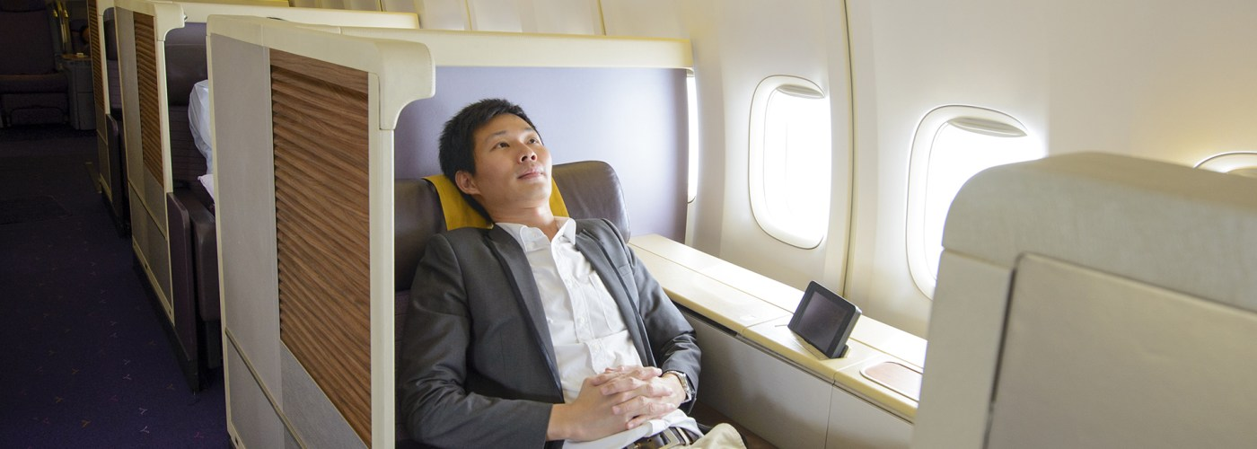 man in first class on airplane.