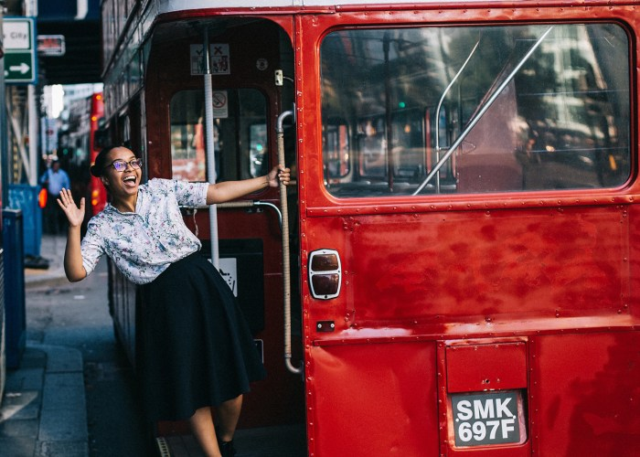 woman hopping on london bus