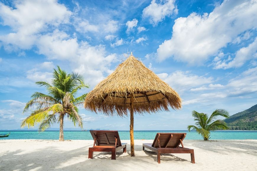 beach chairs on a bahamas beach.
