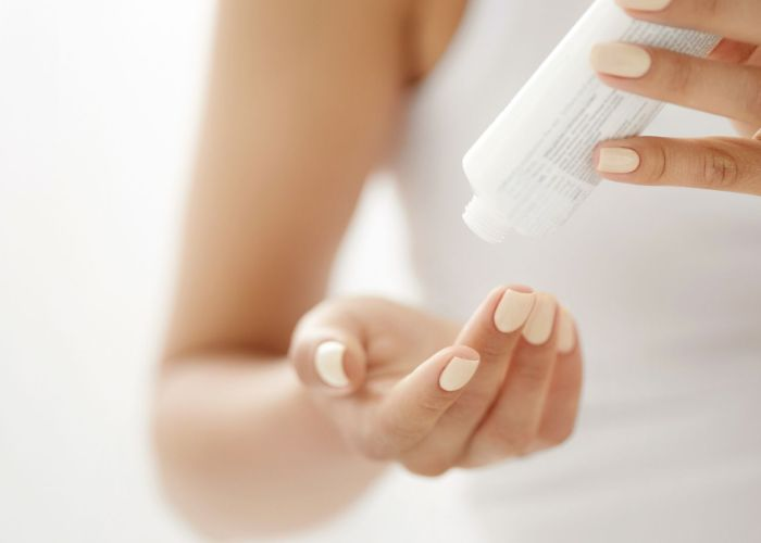 woman's hands with hand cream.