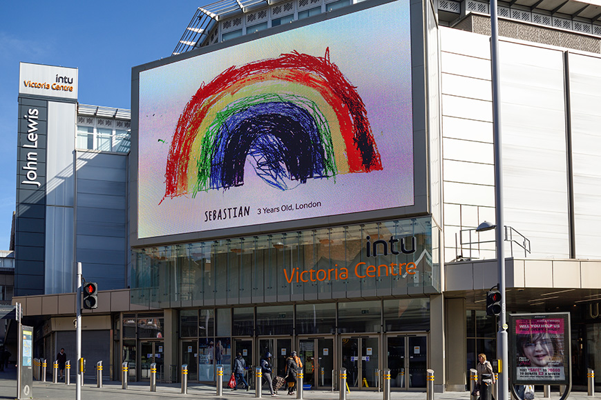 Nottingham city Rainbow messages of hope from children displayed on advertising board outside Intu shopping mall Nottingham.