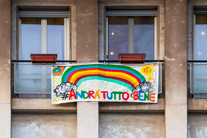 """Italians locked up in the quarantined house display the rainbow flag with the words """"everything will be fine""""."""